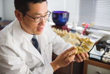 Dr-jae-lim-holding-spine