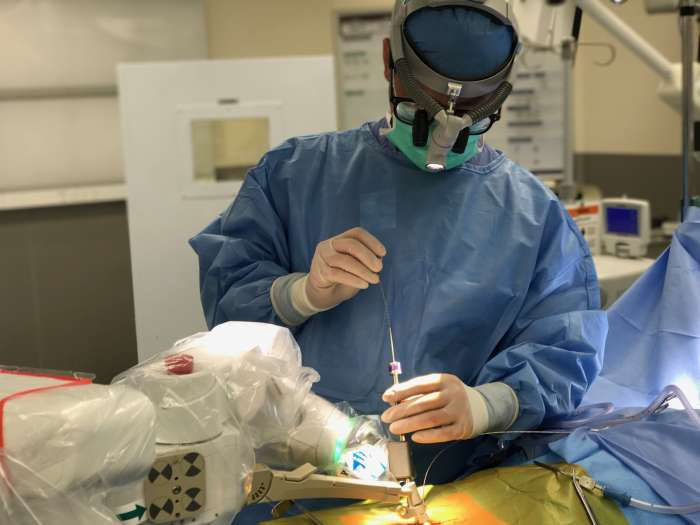 Dr. Lim Performing Robotic Spine Surgery