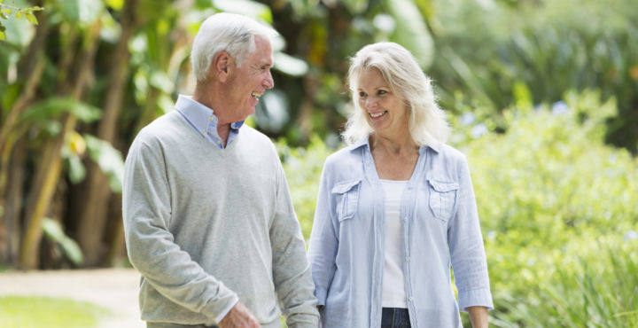 Couple Walking After Surgery From Spine Doctor