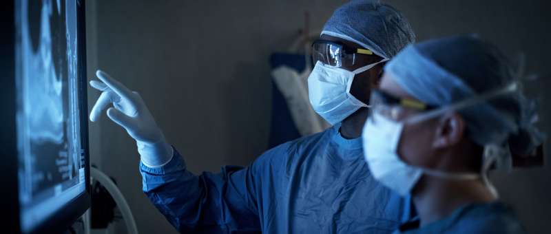 What is the difference between a neurosurgeon and an orthopedic surgeon?