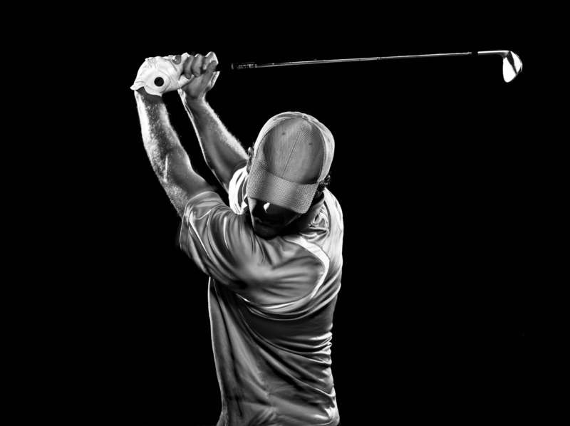 Golfer with herniated disc swinging club